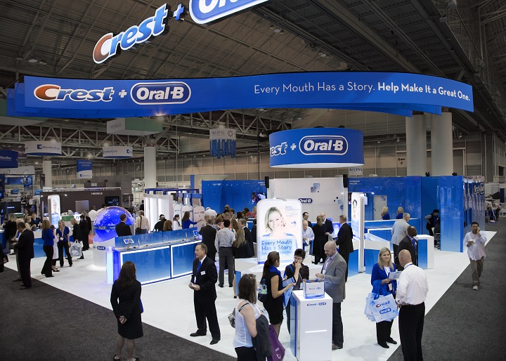 Our booth for Crest + Oral-B included a hands-on science demo area, brushing stations for sampling, and a live presentation theater, where two professional presenters delivered a news-themed message about Crest and Oral-B's latest innovations.