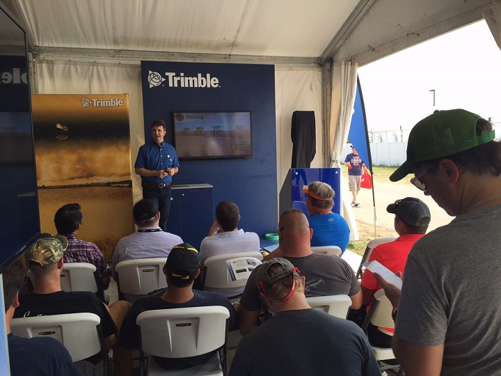 An MPG professional presenter details the benefits of Trimble's Connected Farm software for a packed audience at Farm Progress 2015.